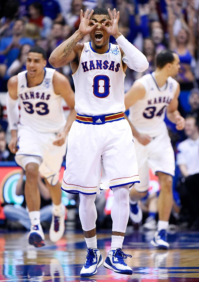 Frank Mason III celebrates his three-point shot against against Texas. Kansas won 69-64.