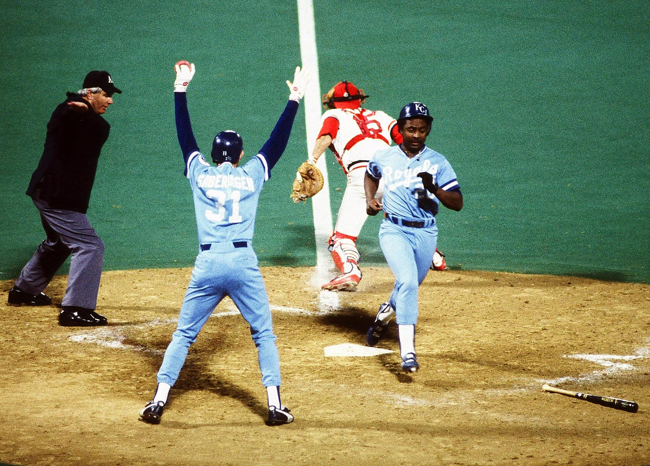 Frank White crosses home plate after hitting a home run in Game 3. The Royals won 6-1 at Busch Stadium.