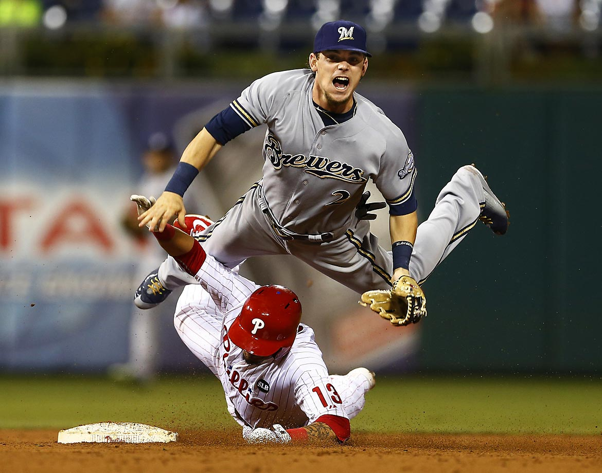 Scooter Gennett of the Milwaukee Brewers turns this double play in the eighth inning against the Philadelphia Phillies.