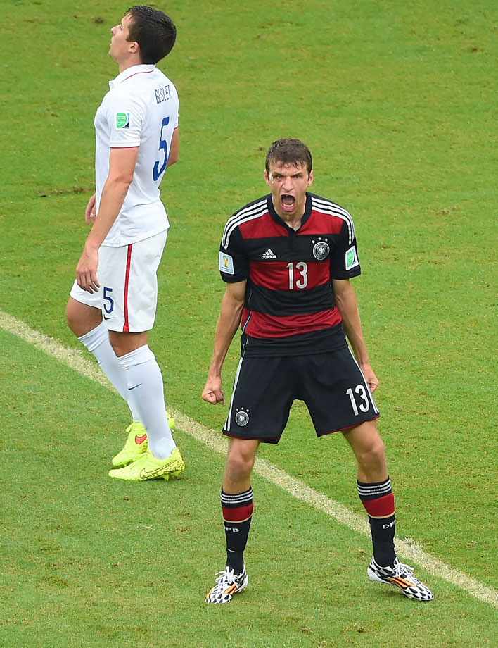 Thomas Muller celebrates his spectacular strike in front of a dejected Matt Besler in Germany's 1-0 win over the USA to close Group G play.
