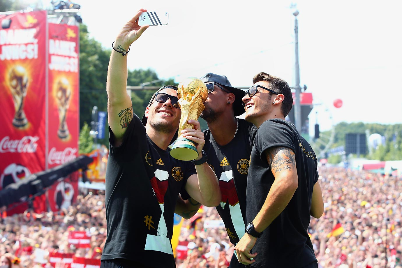 Lukas Podolski, Jerome Boateng and Mesut Oezil.
