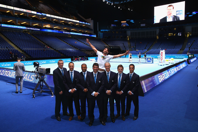 Coach of Marin Cilic, Goran Ivanisevic, jumps behind the line judges as they pose for a team photo at O2 Arena.
