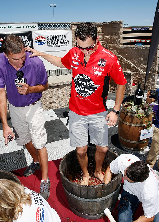 IndyCar driver Graham Rahal competes in a grape stomping contest, against his fiancee Courtney Force, during a racing skills challenge event at Sonoma Raceway.