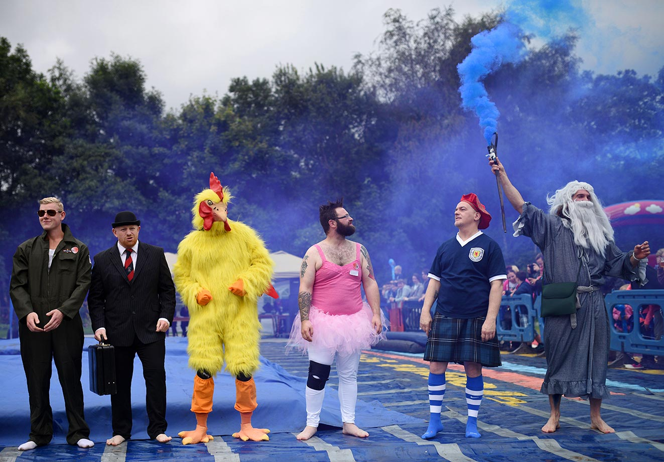 Competitors line up before the start of the 8th annual World Gravy Wrestling Championships.