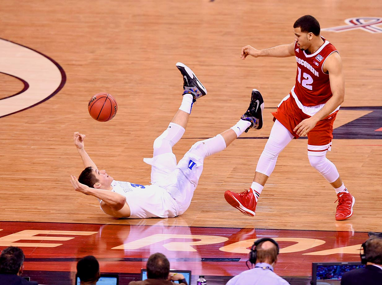 Grayson Allen of Duke takes a tumble with Traevon Jackson standing by.