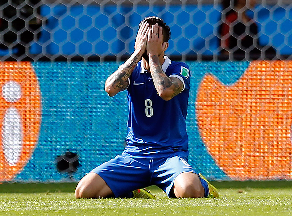 Greece's Panagiotis Kone reacts after missing a chance duringa 3-0 loss to Colombia.