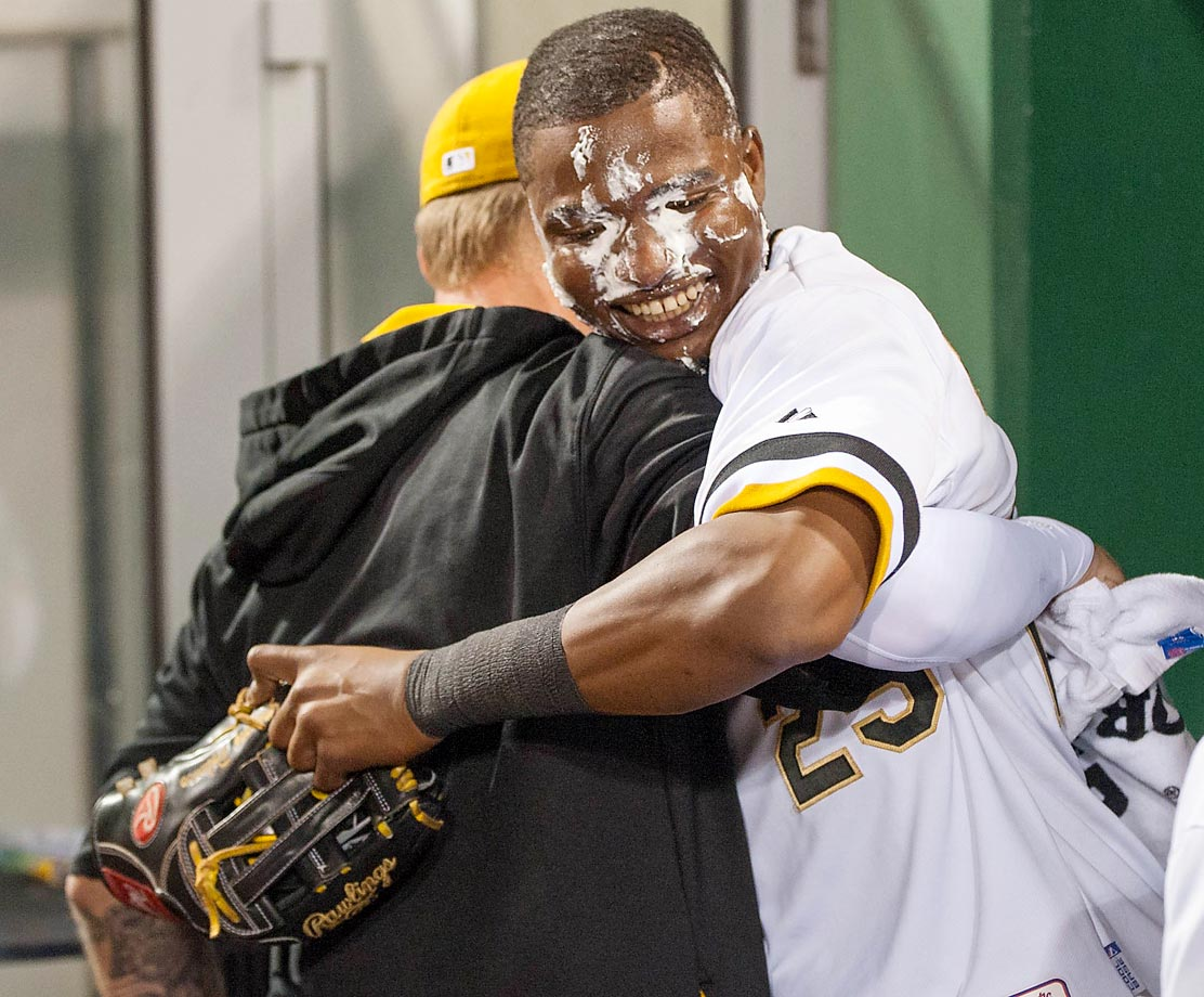 A.J. Burnett of the Pittsburgh Pirates catches Gregory Polanco with a whipped cream pie after Polanco's walkoff single during the 10th inning against the St. Louis Cardinals.
