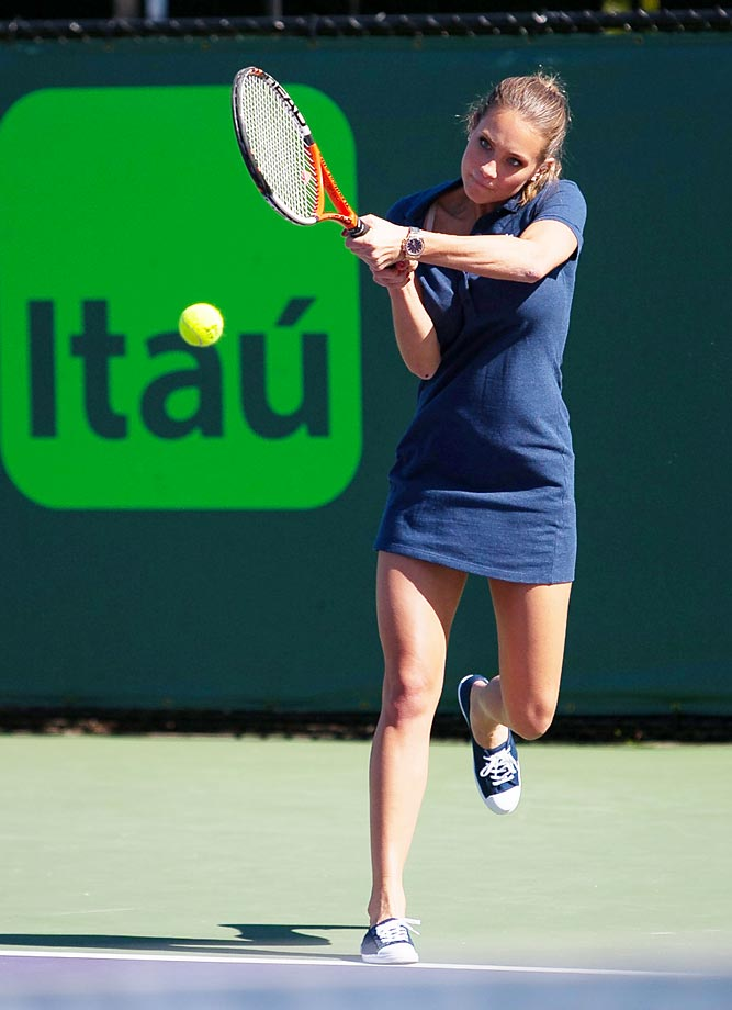 SI Smimsuit model Hannah Davis shows off her other talent during a practice at the Miami Open in Key Biscayne.