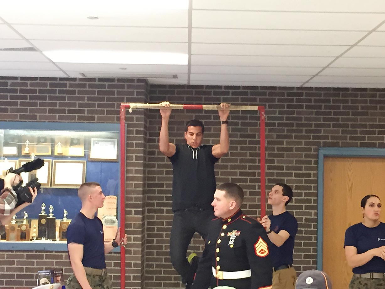 Donn Cabral, eight-time NCAA All-America and 10-time individual Ivy League champion, getting the hang of things at the pull-up bar challenge at the event to honor Hannah DeBalsi, the SI High School Athlete of the Month.