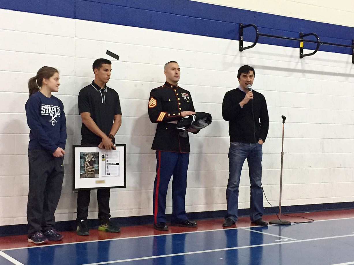Hannah DeBalsi, a top student at Staples High with a 4.13 GPA, is presented with her High School Athlete of the Month Award by (from left) Donn Cabral, SSgt Jason Caldwell and Sports Illustrated Managing Editor Chris Stone.