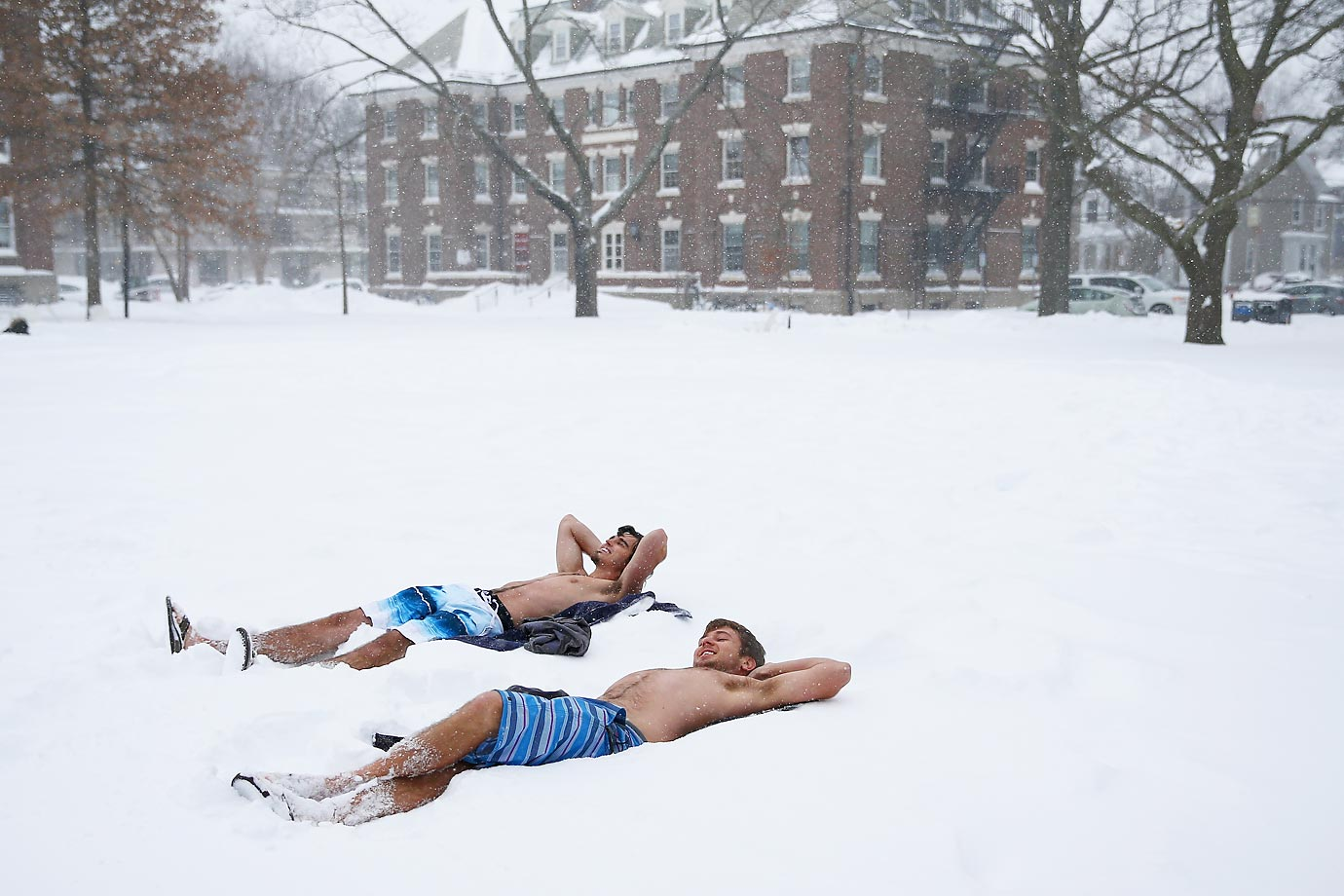 Harvard students lay out in their bathing suits on the Quad during one of the snowstorms last week.