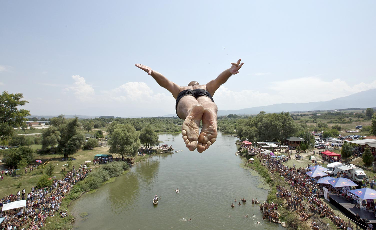 A diver jumps from the Ura e Shenjte bridge during the traditional annual high-diving competition at the Drini i Bardh river.