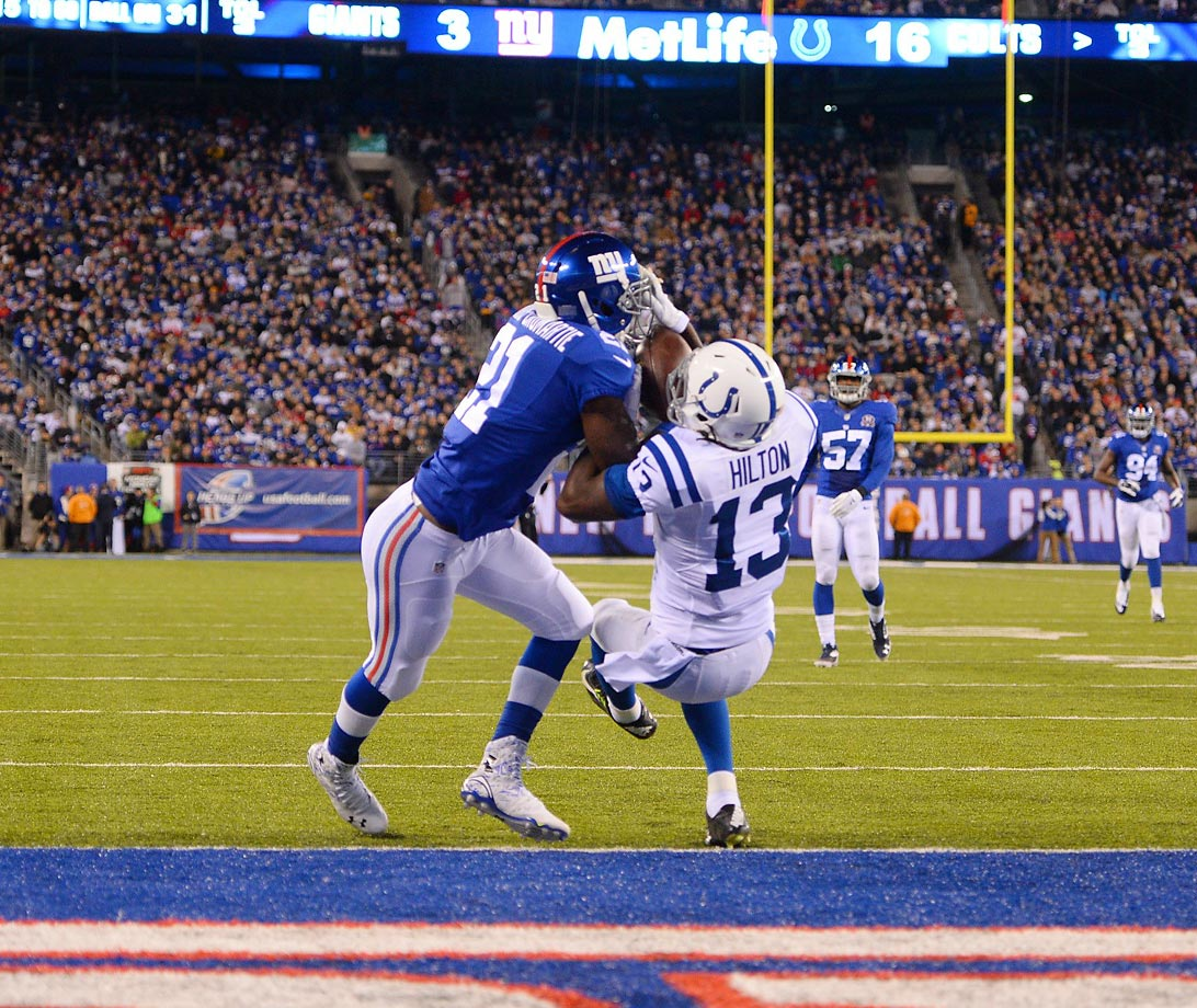 Colts wide receiver T.Y. Hilton catches a 31-yard touchdown pass from Andrew Luck in a 40-24 victory over the Giants.