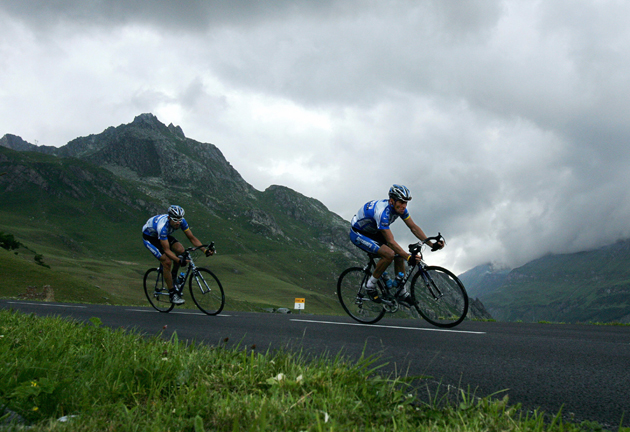 Lance Armstrong rides in front of his teammate George Hincapie during the tenth stage of the 92nd Tour de France race between Grenoble and Courchevel. Armstrong would go on to win the race for his seventh Tour de France title.