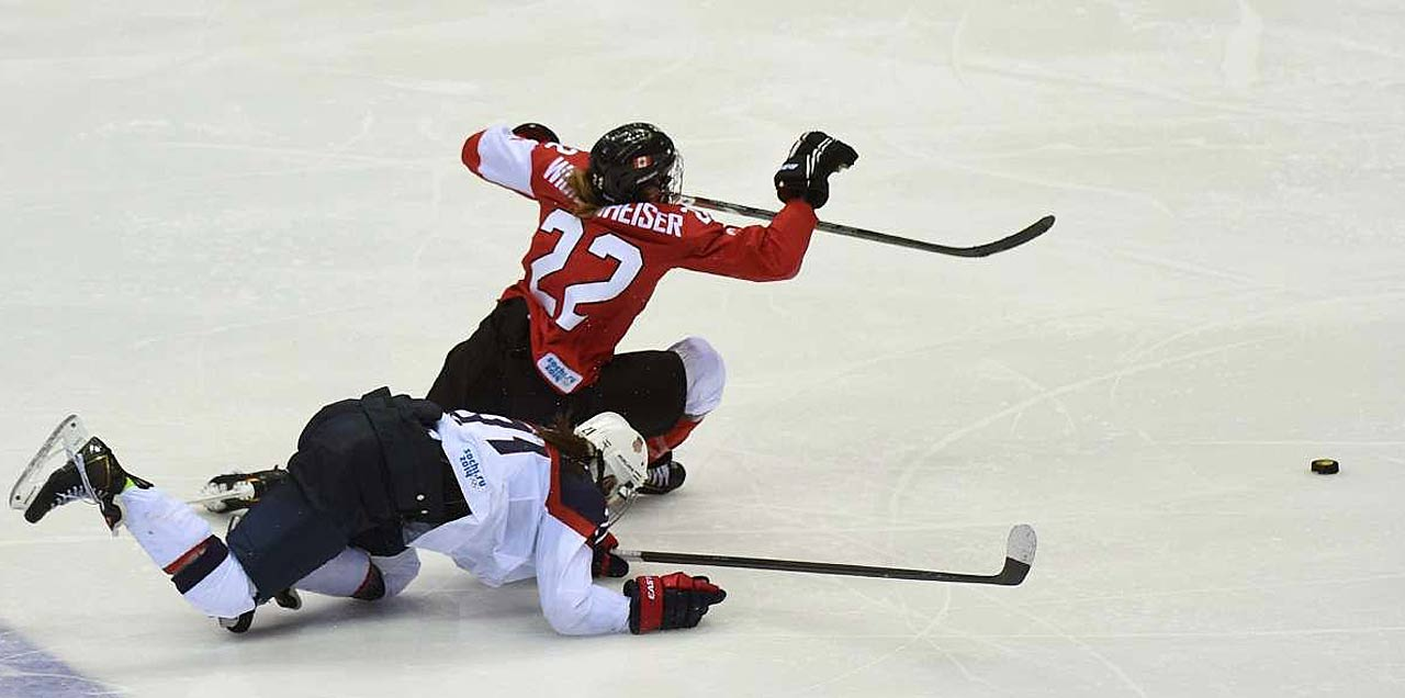 Jocelyne Lamoureux of the U.S. drew a slashing minor for taking down Canada's Hayley Wickenheiser on this breakaway.