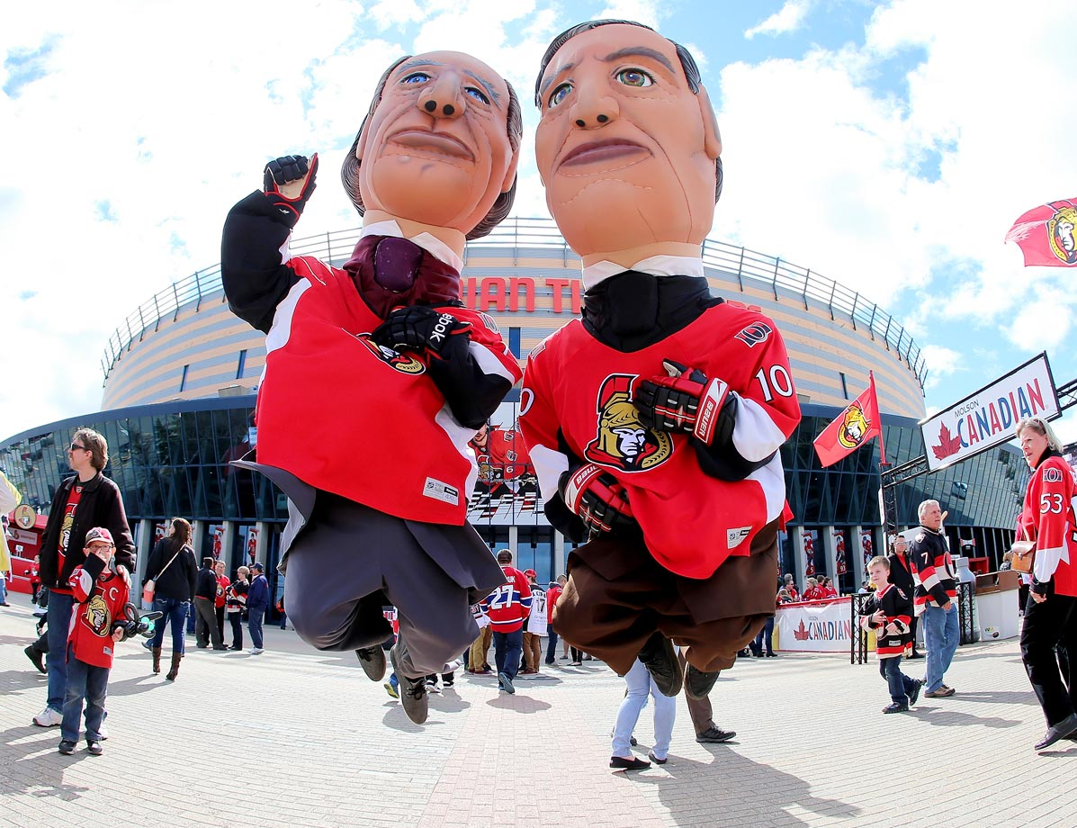 The Prime Minister mascots enjoy the atmosphere prior to the start of the Senators and Canadiens Game 6 of the Eastern Conference quarterfinals.
