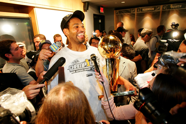 Horry holding the Larry O'Brien trophy, a familiar feeling for the clutch forward.