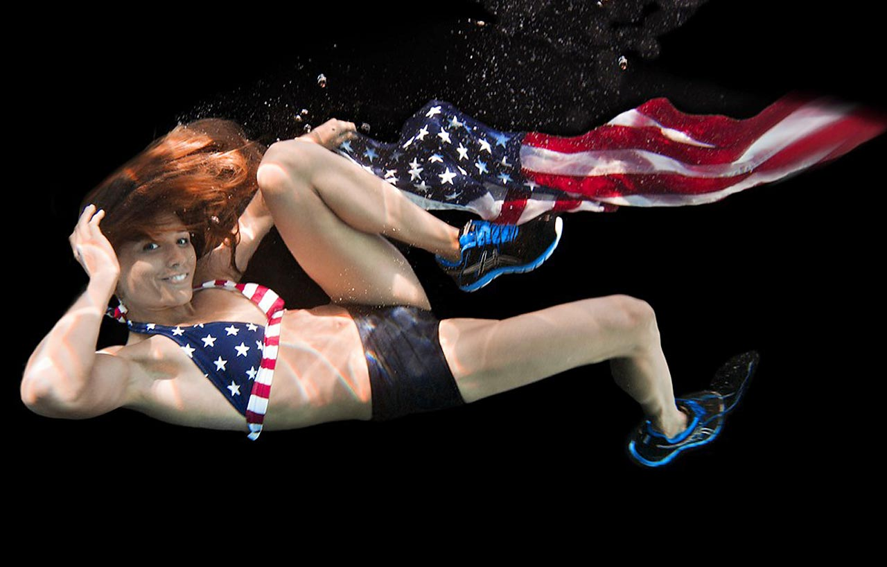 Olympian Lolo Jones in 2012 with the United States flag.