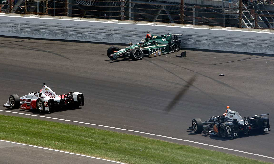 Ed Carpenter's car came skidding to a halt along the wall after he and Oriol Servia collided on Turn 1 with a little more than 250 miles in the books.