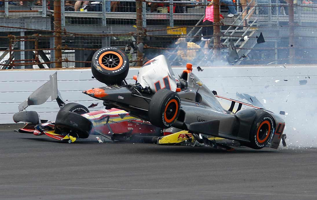 Stefano Coletti (top) collides with Sebastian Saavedra in the final laps.