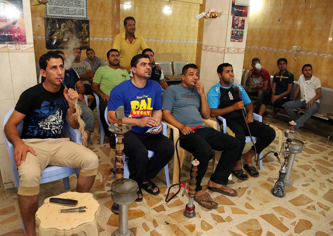 Iraqi youths watch in Sadr City, Baghdad, Iraq.