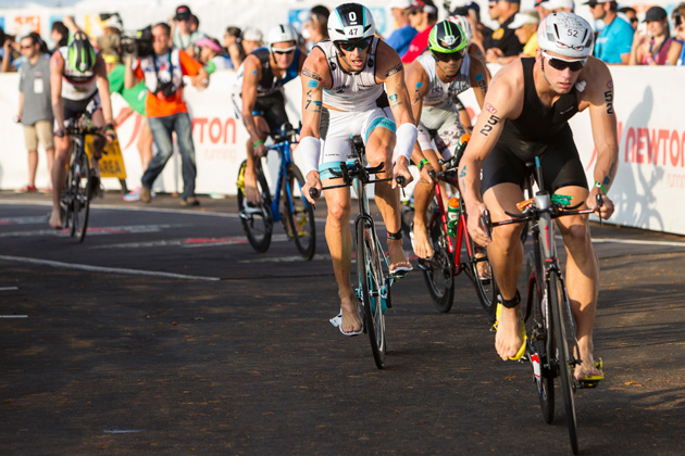 Andrew Starykowicz (52) and Dirk Bockel (47) lead a pack in the bike portion of the Ironman World Championships in October 2013 in Kailua Kona, Hawaii.