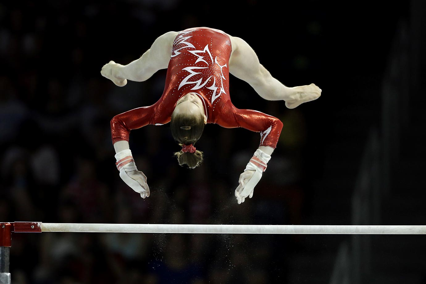 Isabela Onyshko of Canada performs on the uneven bars during women's artistic gymnastics team competition in the Pan Am Games in Toronto.