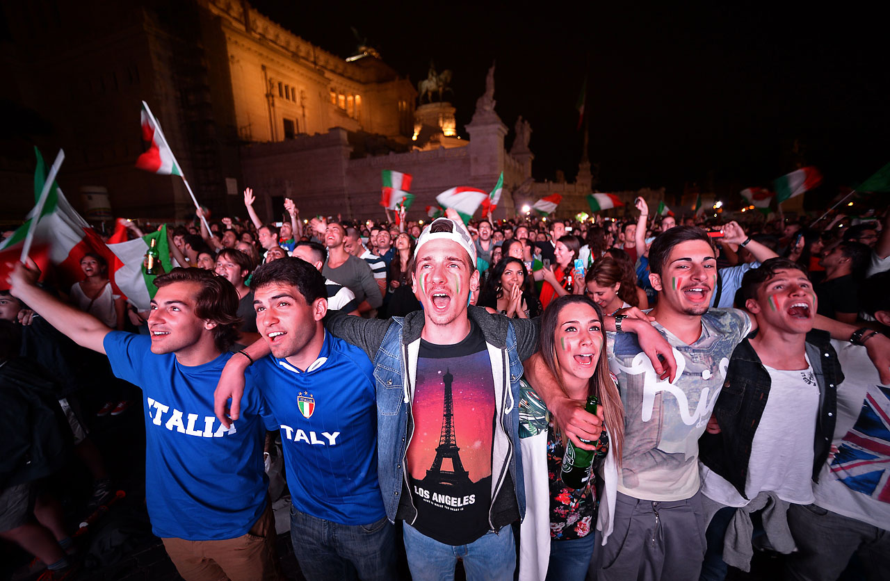 Soccer fans in Rome watch a giant screen in central Rome's Piazza Venezia as Italy defeats England 2-1.
