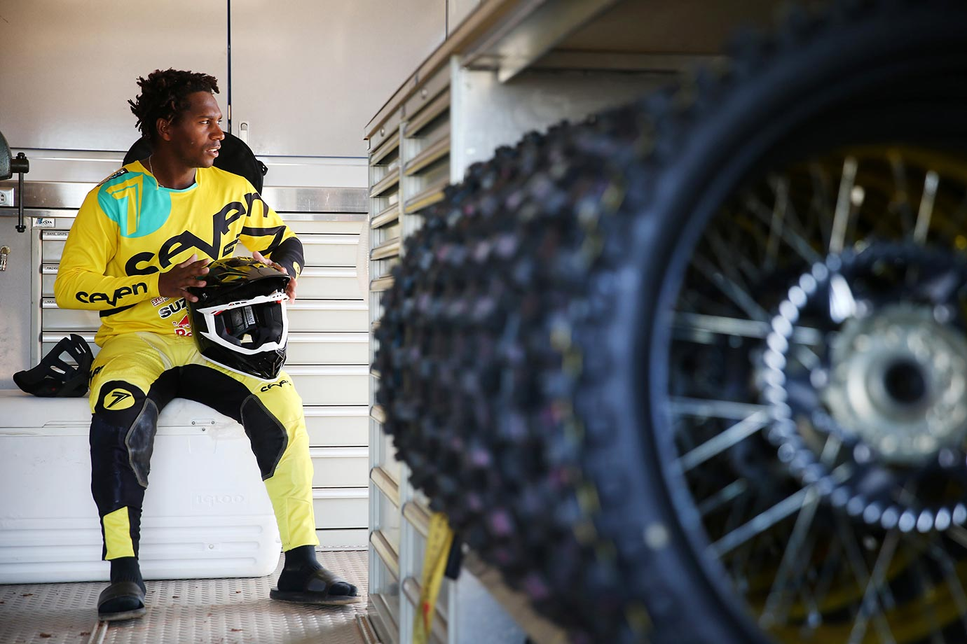 Supercross rider James Stewart suits up in his trailer.