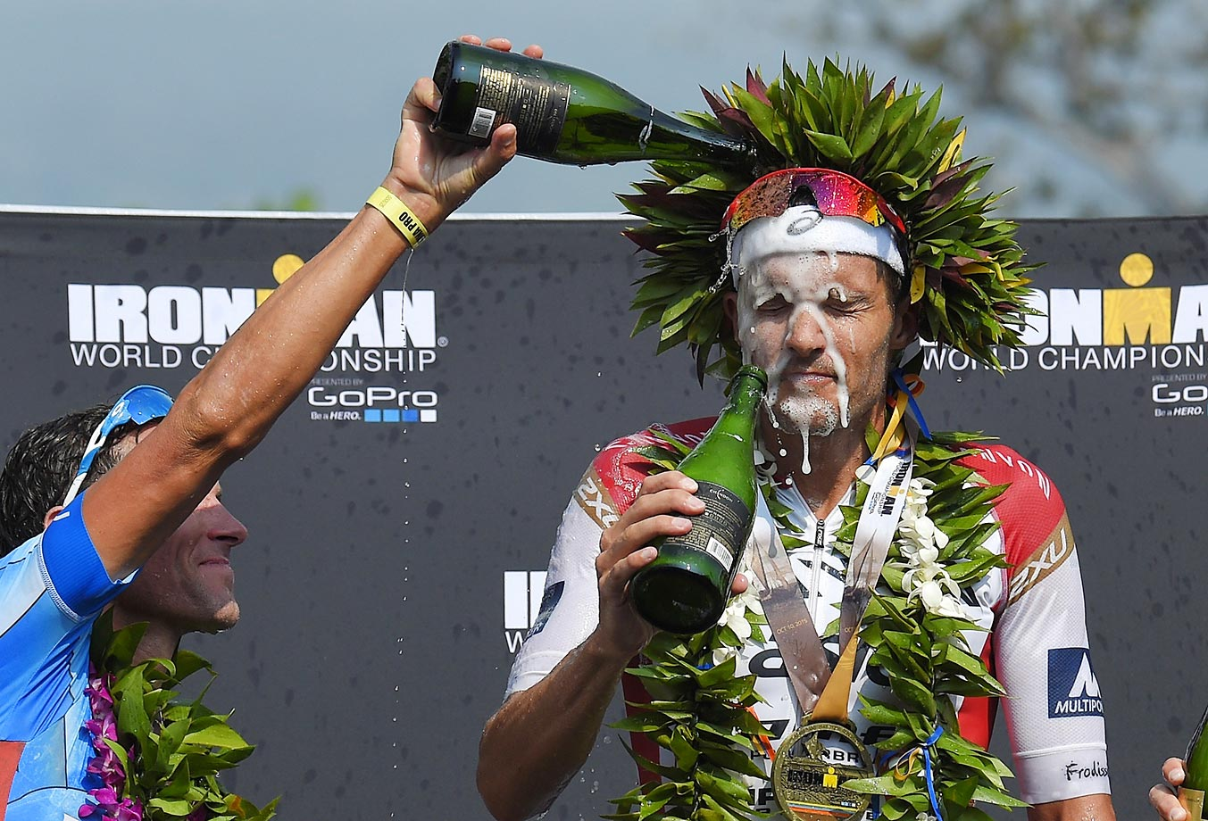 Jan Frodeno of Germany gets doused by champagne after winning the Ironman World Championship triathlon in Hawaii.