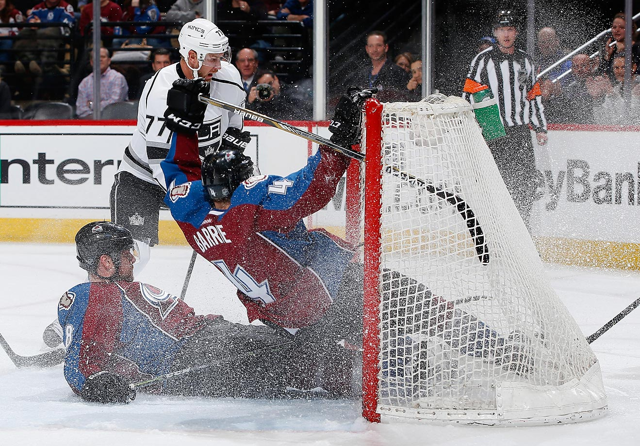 Jan Hejda and Tyson Barrie of the Colorado Avalanche crash into the goal as they defend an empty net against Jeff Carter of the Kings.