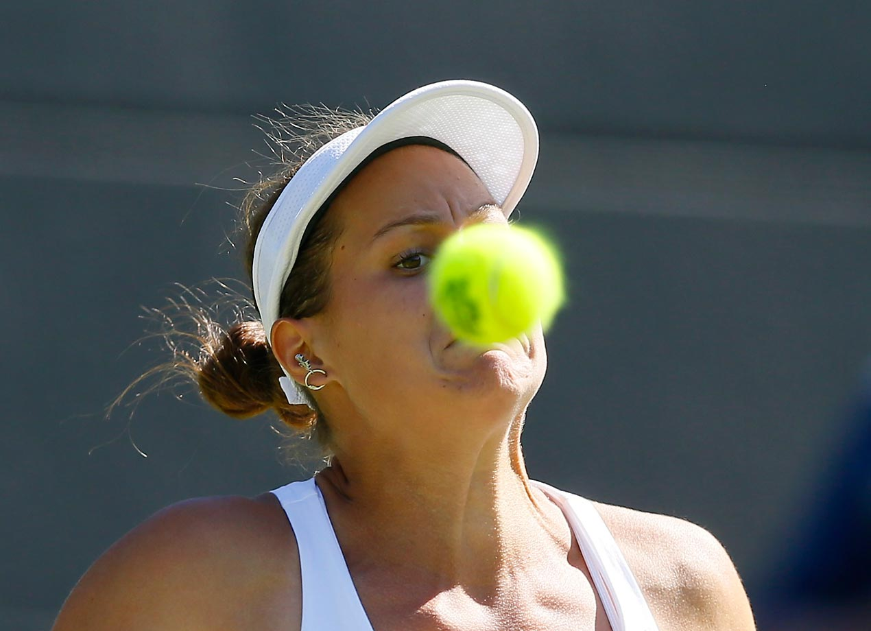 Jana Cepelova watches the ball during her match against Simona Halep at Wimbledon.