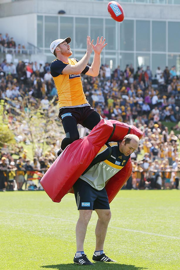 Jarryd Roughead of the Hawks marks the ball over assistant coach David Neitz during a Hawthorn Hawks AFL training session.