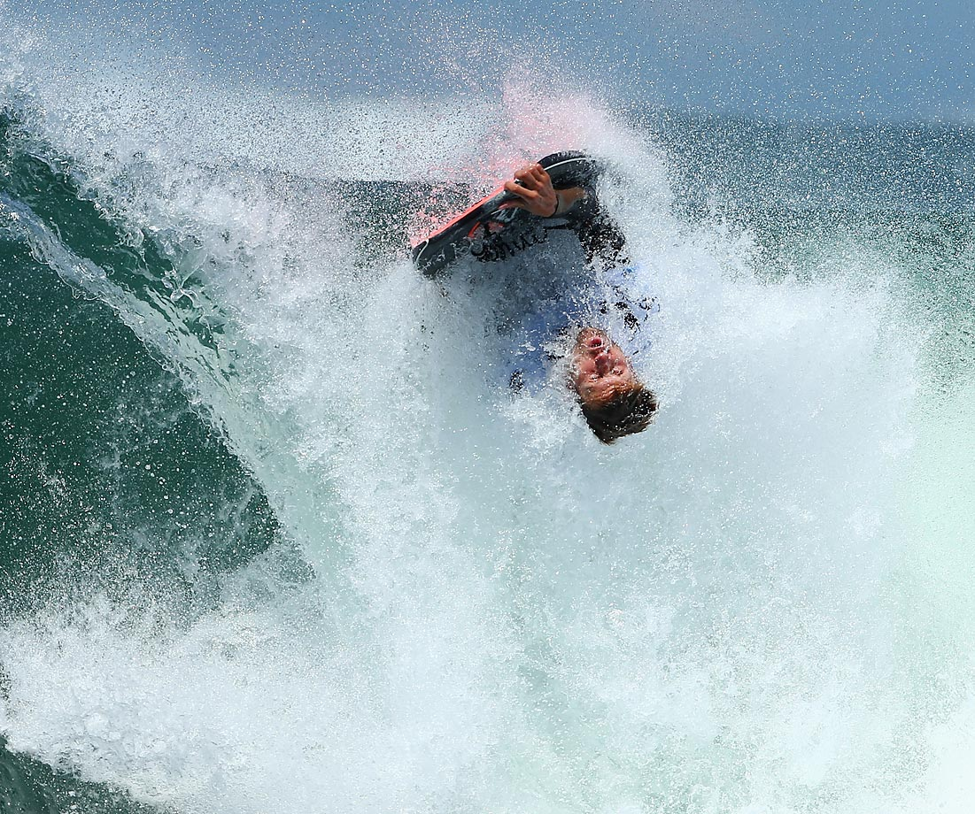 Jase Finlay performs an el rollo during the 2014 Shark Island Challenge at Shark Island.