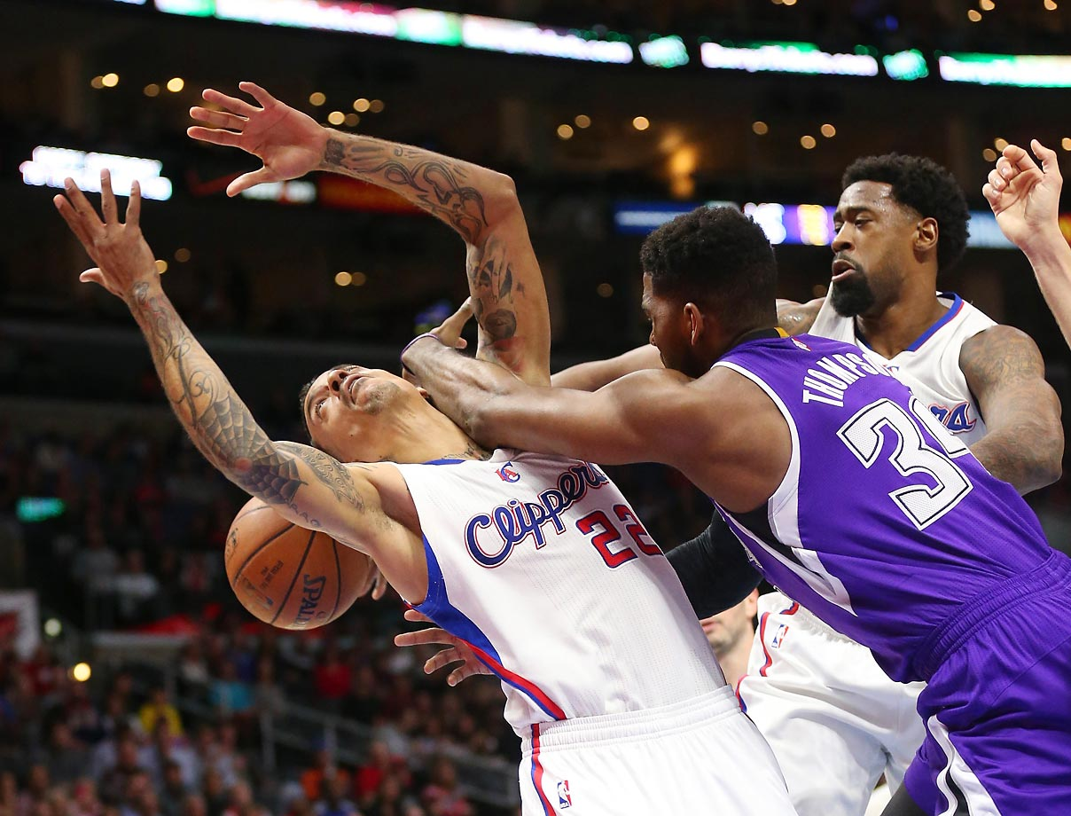 Jason Thompson (34) of the Sacramento Kings battles for the ball with Matt Barnes (22) and DeAndre Jordan (6) of the Los Angeles Clippers.