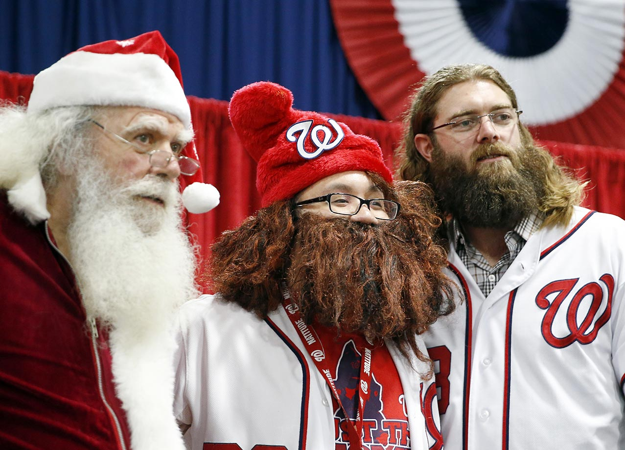 Santa and a fan pose for a photo with Washington Nationals outfielder Jayson Werth during the team's Winterfest fan festival.
