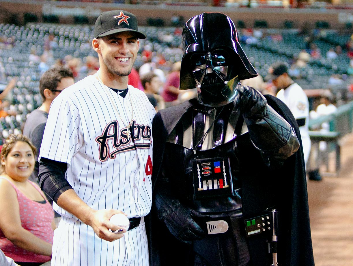 "Houston Astros left fielder J.D. Martinez poses with Darth Vader, celebrating ""Star Wars Night"" before the Astros game against the St. Louis Cardinals on Sept. 26, 2011 at Minute Maid Park in Houston."