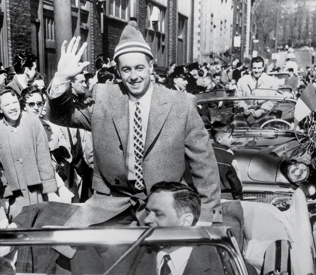 The Canadiens' captain and conquering hero waves to the crowd at the Stanley Cup victory parade in Montreal in mid-April 1956.