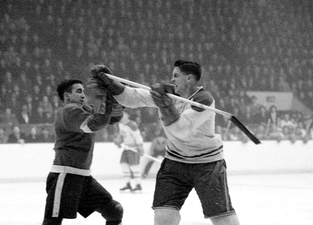 "Jean Béliveau aka ""Le Gros Bill"" mixes it up with Red Wings left wing Terrible Ted Lindsay during a game in Montreal on Feb. 17, 1955."