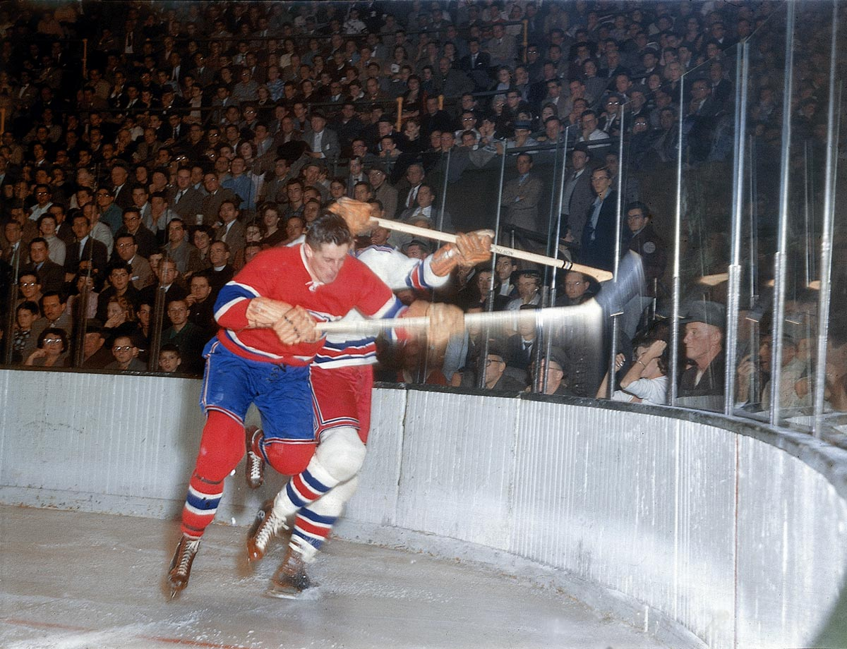 Jean Béliveau checks Rangers defenseman Lou Fontinato into the boards during a game in New York on Nov. 27, 1955.