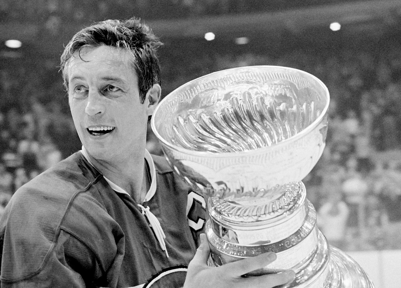 Jean Béliveau holds the Stanley Cup after his final game, a 3-2 victory over the Chicago Blackhawks in Game 7 of the Stanley Cup Finals on May 18, 1971.