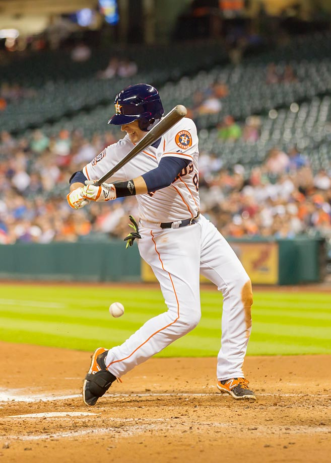 Jed Lowrie of the Astros gets hit by a pitch in a game against the A's.