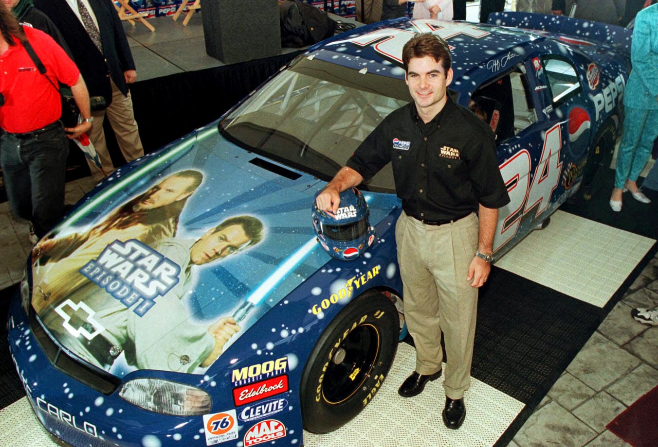 Jeff Gordon stands by his new Busch Grand National series car during a news conference to announce the Star Wars Episode I sponsorship for his team in the Carquest 300 race on May 26, 1999 in Concord, N.C.
