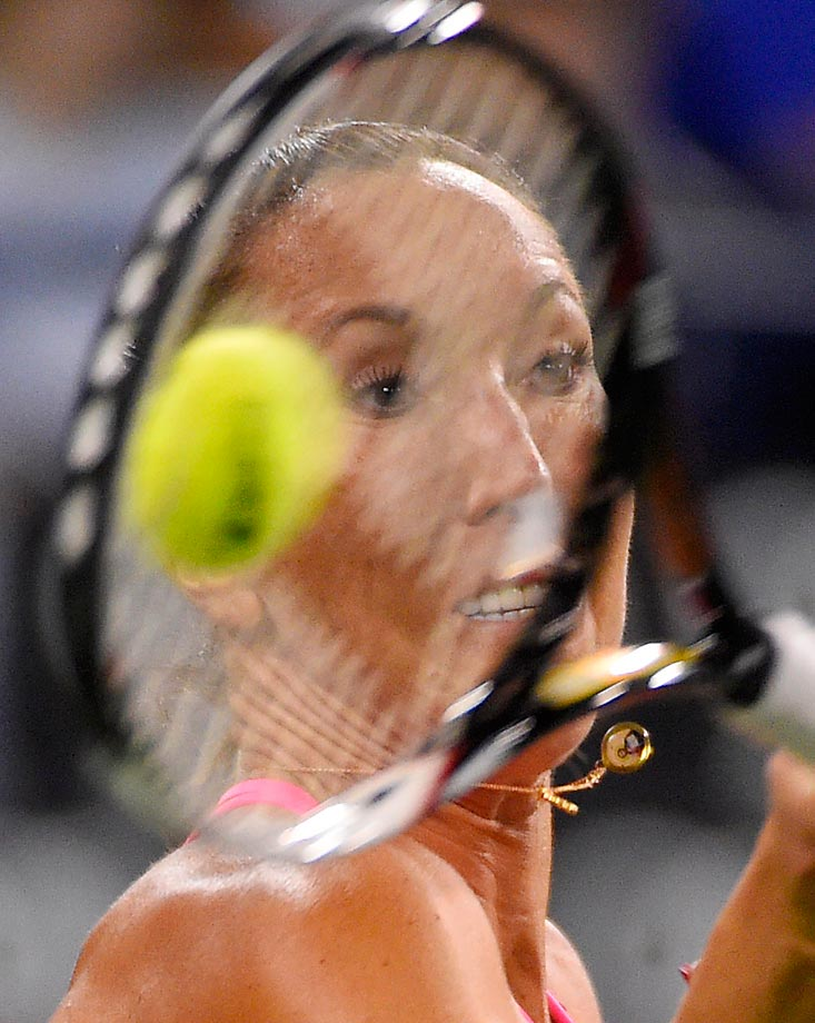 Jelena Jankovic returns a volley from Sabine Lisicki during their match at the BNP Paribas Open.