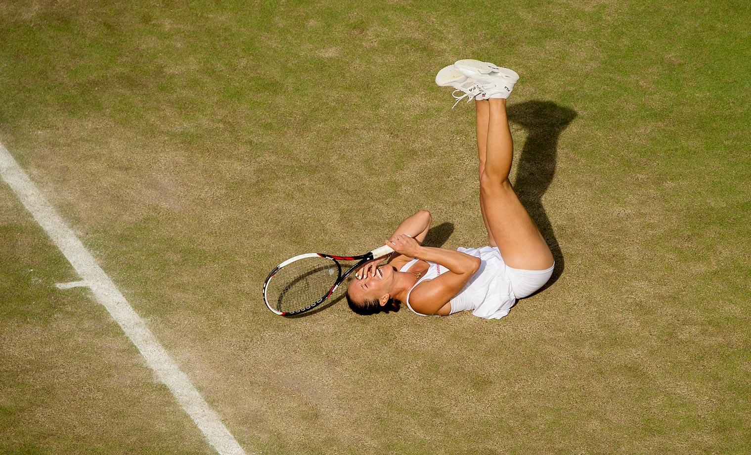 Jelena Jankovic playing against Petra Kvitova in the third round at Wimbledon.