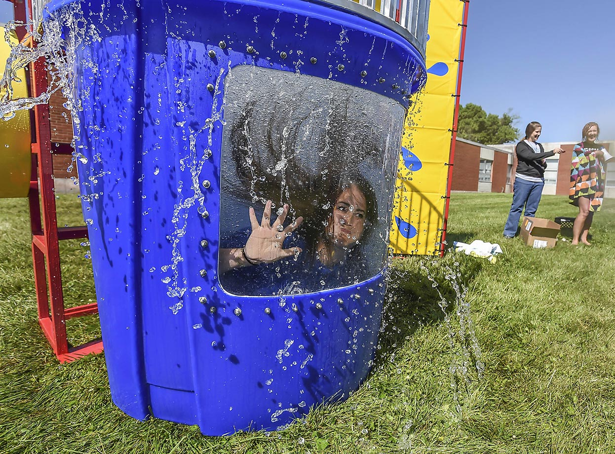 "Jennifer Fowler waves to students after getting dunked during the Junction City Elementary School ""Dunk Mrs. Shunk"" event."