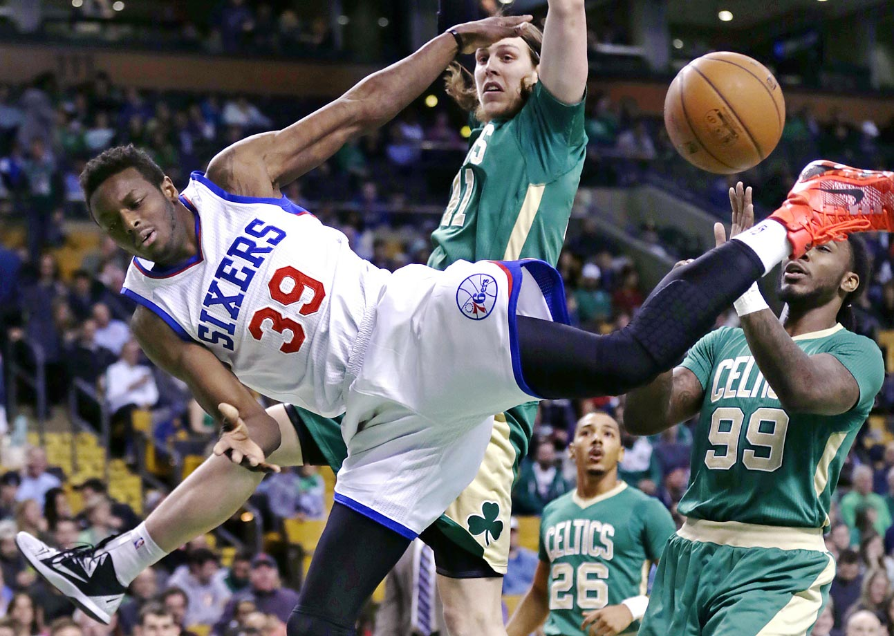 Jerami Grant of the Philadelphia 76ers loses control of the ball against Boston Celtics center Kelly Olynyk and forward Jae Crowder. The Celtics defeated the 76ers 108-89.