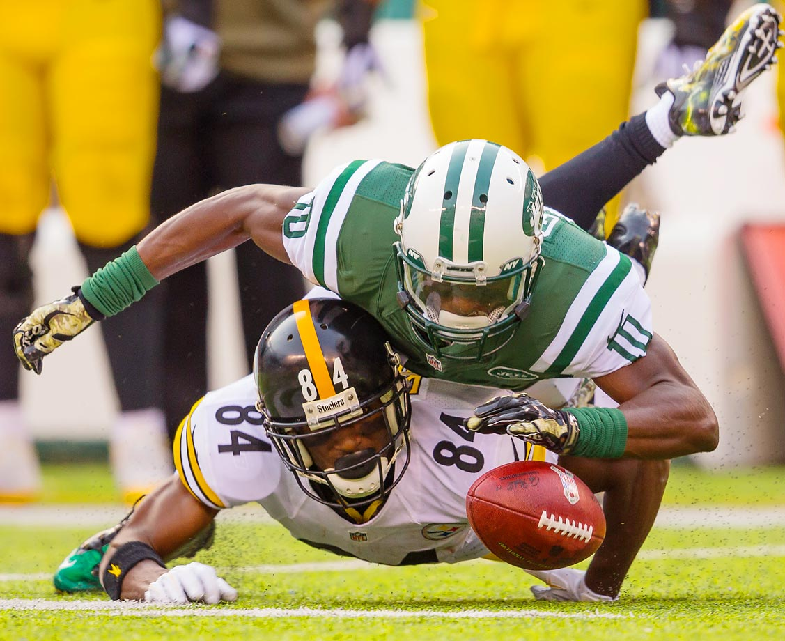 Pittsburgh Steelers wide receiver Antonio Brown fumbles a kickoff and is tackled by the New York Jets' T.J. Graham, who recovered the fumble.