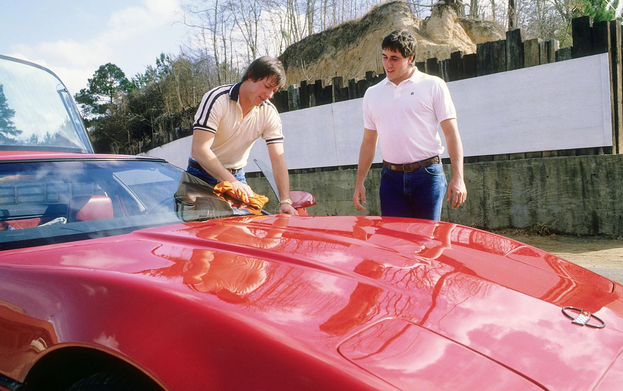 Former Houston Gamblers and Buffalo Bills quarterback Jim Kelly scrubbing his 1984 Crossfire Injection Corvette along with his brother Danny.