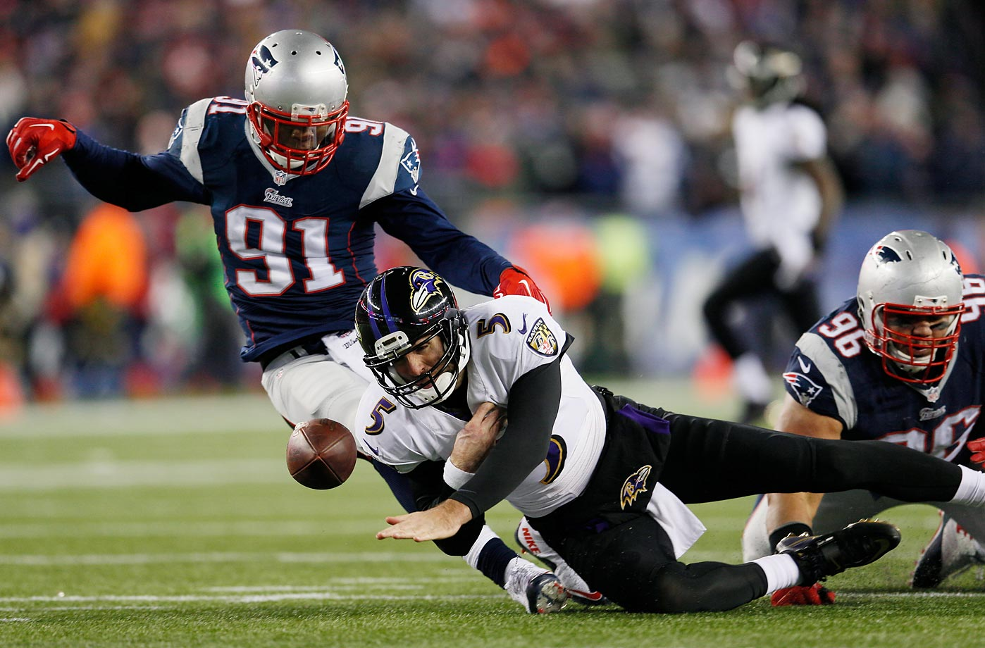 Baltimore Ravens quarterback Joe Flacco fumbles against the New England Patriots during their AFC Divisional Playoff game.
